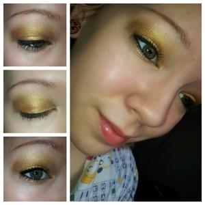 Gold eyeshadow looks good on green eyes.