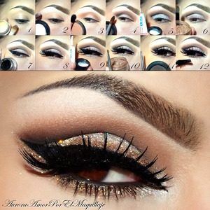 1)Apply a base shadow on the eye lid in skin tone #NYXcosmetics 2)Highlight your brow bone w/ white mate shadow Gesso of MAC 3)Blend on your crease a matte e/s like Soft Brown of MAC 4)Mark your socket w/ black e/s Carbon de MAC 5)Apply glitter glue on the eyelid  & place a white-silver glitter on it MAC or any brand. 6)Place a golden-bronze pigment over the glitter in the lower part of the lid 7)Line your top lashes w/ gel liner in black ELF #elfcosmetics 8)Place some dramatic false lashes like #201 Glamour of Ardell 9)Place more white-silver glitter below lower lashes & extend it through top liner 10)Place more pigment over the glitter previously applied 11)Line your waterline with a dark brown shadow or liner Embark of MAC 12) Apply mascara in top & lower lashes. THAT'S IT!! Enjoy it .