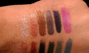 Urban Decay's Loose Pigments from Left to Right: Yeyo, Shag, Smog, Gunmetal, Rockstar, and Asphyxia