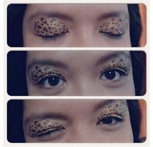"""Saw this awesome tutorial on Youtube on how to do the """"cheetah print"""" eyes, so I gave it a shot. Nevermind my huge eyebags though."""
