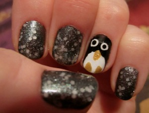 For this manicure I used: Sally Hansen Black Out Sally Hansen White On  China Glaze Champagne Bubbles (feet and beak)  OPI Pirouette My Whistle  OPI Lucerne-Tainly Look Marvelous