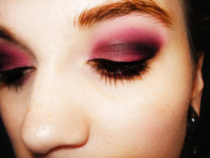 A simple smokey eye done with pink instead of the usual neutral tones.