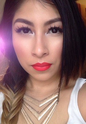Lady danger lipstick by Mac cosmetics and a little bit of summer by melt cosmetics on my lips