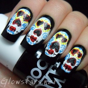 To find out more about this mani visit http://glowstars.net/lacquer-obsession/2012/10/the-digit-al-dozen-does-halloween-sugar-skulls