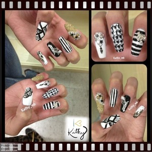 Black and white nails with gold glitter