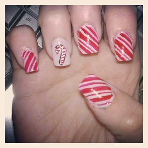 candy cane stripes with a candy cane on my ring finger