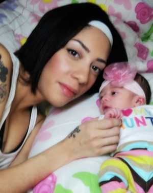 my new edition and i..... alyvia beth born dec 18th at 6:54am weighing 6lbs 8oz and 18 1/2 inches tall