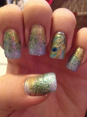 Peacock inspired ombré nail design