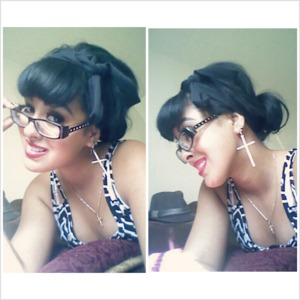 Simple, Pin-up style up-do.