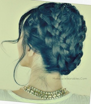 This braided summer hairstyle tutorial can be found on my YouTube channel here.  :)