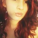 red hai,r long eyelashes ,lip gloss