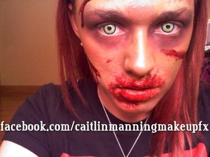 2D Zombie makeup using a Mehron bruise wheel, some fake blood and spooky contacts