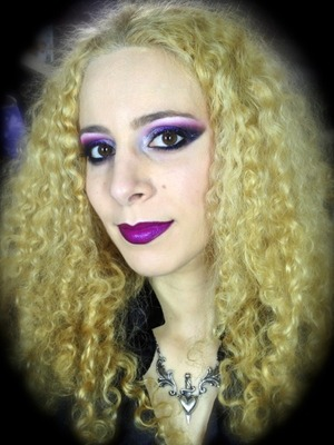 http://michtymaxx.blogspot.com.au/2013/05/black-sabbath-gig-makeup-ootd.html  I went to the Black Sabbath gig and decided to created a dark and witchy look with colours that come to mind when I think of the grandfathers of heavy metal. I layered different purples, and added a bit of silver and black, plus some glitter here and there for a striking finished result.