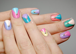 I used 9 Sinful Colors pastel polishes that I got for $1 each during the Walgreens sale! I freehanded the chevrons with a striper brush and just stuck the studs in while the polish was wet.  http://www.dressedupnails.com/2013/02/geometric-challenge-day-9-mix-and-match.html