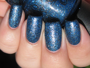 OPI Absolutely Alice and Nicole by OPI Pitch Black Glimmer sunlight, with topcoat