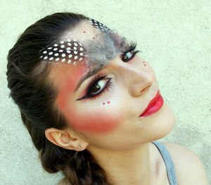 http://www.theglamcrush.com/2012/05/red-eye-shadow-and-pretty-feathers.html