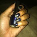 Dark blue and gold dusted nails