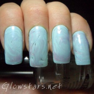 To find out how to achieve this look please visit http://glowstars.net/lacquer-obsession/2012/09/30-days-of-untrieds-marble
