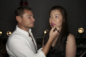 Makeup maestro Tom Pecheux giving my lips a hot pink touch up backstage at the Badgley Mischka fashion show.