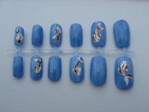 Buy them here: http://www.etsy.com/listing/107692177/koi-fish-nail-set