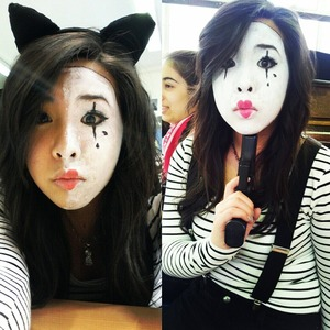 Mime make up using white cream face paint, black liquid eyeliner and red lipstick.