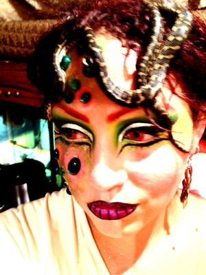 this is a halloween look that i was messing around with,  and i used my baby coastal python as a head dress , ;] he's such a great little dude