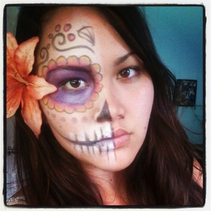 I absolutely LOVE el dios de los muertos (the day of the dead). Only did half my face to show the contrast. not completely satisfied because I didnt have the right makeup. hope you guys like it!