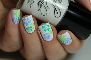 Cult Nails Tempest stamped with IsaDora Scuba Blue, Poseidon & Paradise Green. The IsaDora cremes are so great for stamping. The flowers are from XL plate F, I love it it's so versatile. :) Thanks for looking!