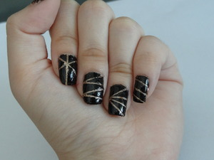 Hi! This is a design is black and gold glitter nail art. I used striping nail tape to help me with this (: