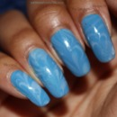 A very light and delicate, milky white and blue water marble