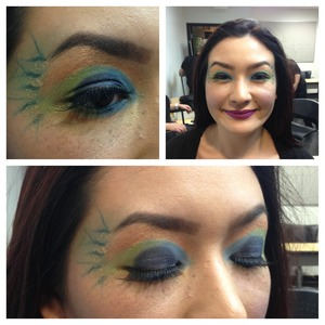 Fun with colors and shapes for peacock feather inspired eyeshadow.