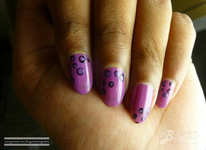 ** OPEN ME TO READ **  Hi Guys,    This is another very easy nail art tutorial.. Their are some many nail art designs done with just using dots. They look hard but once you know how to do them, its very simple.  You can also use any items that you have to create the dots, you do not need the dotting tools. I just love how the purple and black combination has turned out :).  I hope you like this video :D..  Did you try it?...Do share your views with me.. Thank you so much for watching my video :D.. Your support means a lot to me :)).. Please don't forget to like,share and comment..     If you want to view pictures and tutorial visit my blog: http://bangalorebengalurublog.blogspot.in/2013/05/tutorial-nail-art-dots-fast-and-easy.html     Disclaimer:  I have bought the product's mentioned in the video with my money.. Any reviews/thoughts/etc about it is my own opinion.. I am in no way affiliated with the company..     You might also like to view other nail art tutorial's that I have done 1. Tutorial : Nail Art : Marble Nail Art Effect Without Water    http://www.youtube.com/watch?v=M3TzhX3btmI 2. Tutorial : Nail Art : Using KONAD image plate m73    http://www.youtube.com/watch?v=7podhopcVtI 3. Tutorial : Nail Art : Effect created using plastic bag    http://www.youtube.com/watch?v=fXRogE_dw8g 4. Tutorial : Nail Art : Color Blocking effect    http://www.youtube.com/watch?v=HNDS2eROriA 5. Tutorial : Nail Art : Braided effect    http://www.youtube.com/watch?v=CQv4ckthYnU 6. Tutorial - Nail Art - Ombre / Gradient effect .. Easy Valentine's Day nail art    http://www.youtube.com/watch?v=4EjFjw-ANEE  7. Tutorial - Nail Art - Fire effect using paint brush .. Very easy - BangaloreBengaluru    http://www.youtube.com/watch?v=IMJ_Pe0dPxY  nail polish's that I have reviewed 1. ELLE 18 Color Bomb collection nail polish number 34 review    http://www.youtube.com/watch?v=J2wmLuYKClg 2. review : Earthen Rose nail polish number 68 by COLORBAR    http://www.youtube.com/watch?v=WJVfm2icfS