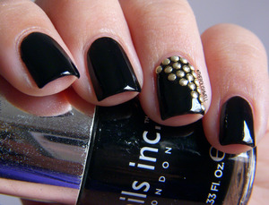 http://thepolishwell.blogspot.com/2012/12/nail-ideas-studded-nails.html