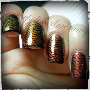 March Nail Art Challenge: Chevrons. http://www.thepolishedmommy.com/2013/03/magical-illusion.html