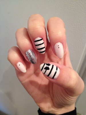 Natural stiletto nails with free hand painted stripes