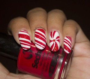 http://www.bellezzabee.com/2013/12/christmas-candy-canes-nail-art.html