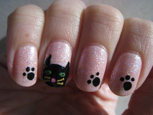 Glittery nails topped with some feline fanciness