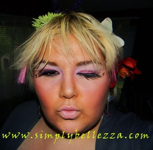 LOL. I laugh every time I see my Ganguro face. This is a more modern take on the Japanese look. =D