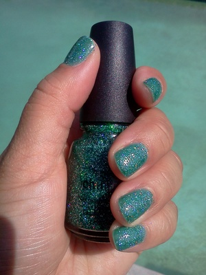 China Glaze Atlantis (sometimes the glitters look like tiny lights)