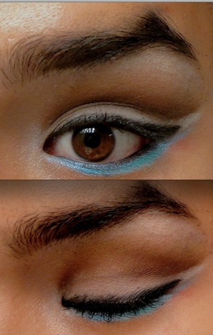 Cut crease with matte brown, matte white over lid with winged out gel liner, blue highlight on lower lash line