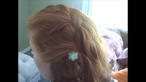 Waterfall braid with fishtail end and jewelry.