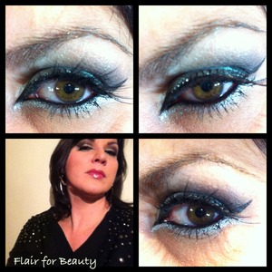 a glam party look in black and silver, with graphic eyeliner and swarovsky decorated falsies.