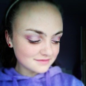 I used a peach colour all over my lid.Then I applied purple to the outer corner and up into the crease down to the other side of my eye lid.I used a fluffy brush to soften its edges.Then I applied white eyeshadow into my inner corner and then blened it out onto my lower lash line.