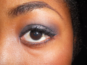 Silver, Black, and Blue Smokey Eye with a slight winged liner.