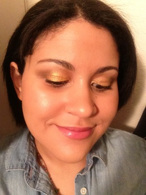 I used a Maybelline Color Tattoo with chunky gold glitter (Gold Rush, I think) and felt glam and healthy-looking!