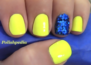 Simple design that pops and is bound to be seen and admired!    Watch My Video Tutorial @ http://polishpedia.com/neon-yellow-nails-with-a-blue-glitter-accent-nail.html
