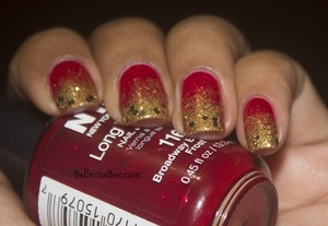 Classic red and gold colours for the holidays http://www.bellezzabee.com/2012/12/solar-flare-christmas-nails.html