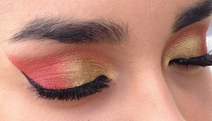 She is beautiful to begin with but that gold and red brought out her eyes so much :)