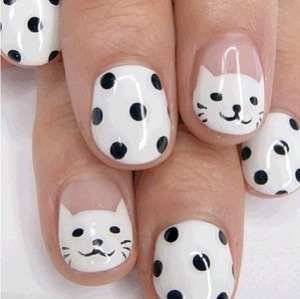 Adorable kitty and polka dot nails.