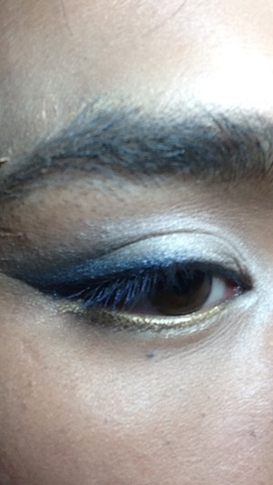 This is a winged shadow look for prom, clubbing, or just a fun look to do. Used a cotton swab and makeup cleansing oil to get sharp outer edge